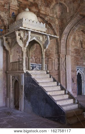 MANDU, MADHYA PRADESH, INDIA - NOVEMBER 18, 2008: Steps leading to a stone platform or mimbar, used by a preacher, inside the prayer hall of  the mosque of Ashrafi Mahal Mosque in the hilltop fortress of Mandu in Madya Pradesh, India. 15th Century AD