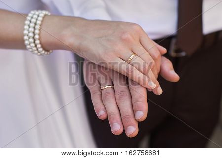 Bride and groom with wedding rings on their hands male and female hand with wedding rings wedding ceremony together forever