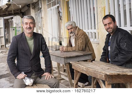 Chokam IRAN - December 16 2016 Group of Men in Front of Storefront Outdoor. Gilan Province