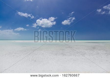Amazing, gorgeous natural background view of turquoise, tranquil ocean merging with clear beautiful sky at horizon line on sunny warm day at Cayo Coco island, Cuba