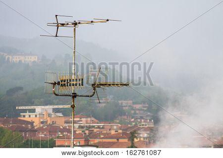 Antenna on the roofs, Bologna, Italy, San Luca