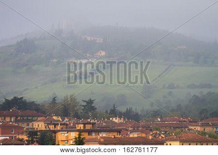San Luca monastery on foggy day, Bologna, Italy