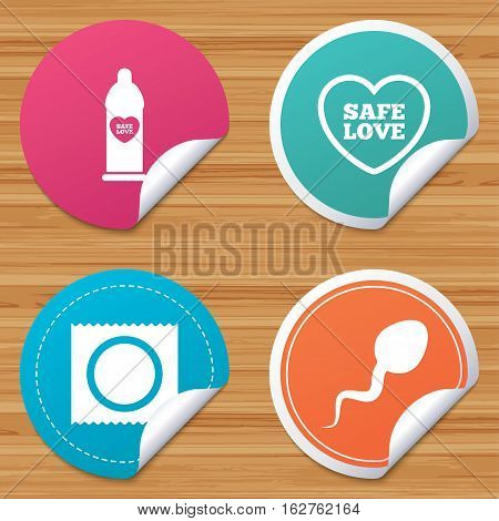 Round stickers or website banners. Safe sex love icons. Condom in package symbol. Sperm sign. Fertilization or insemination. Circle badges with bended corner. Vector
