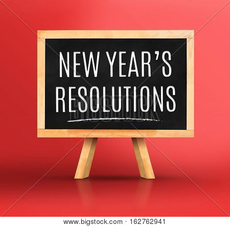 New Year's Resolutions Word On Blackboard With Easel On Vivid Red Studio Backdrop,new Year Planning