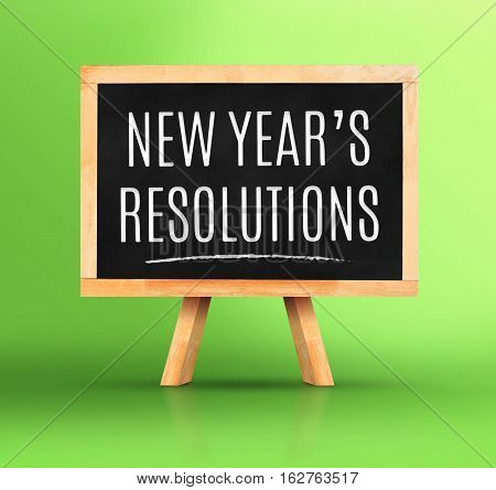 New Year's Resolutions Word On Blackboard With Easel On Vivid Green Studio Backdrop,new Year Plannin