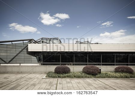 modern architecture against a blue sky blank floor prospects