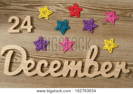 Christmas Eve Date On Calendar. December 24. Wooden Background. 24th day of calendar last month of the year.