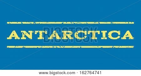 Antarctica watermark stamp. Text caption between horizontal parallel lines with grunge design style. Rubber seal stamp with unclean texture. Vector yellow color ink imprint on a blue background.