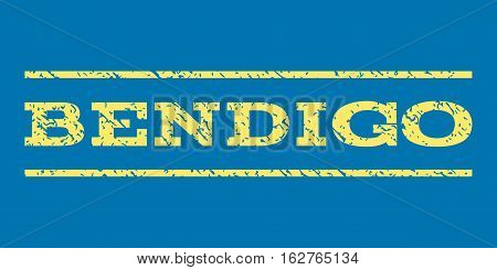 Bendigo watermark stamp. Text tag between horizontal parallel lines with grunge design style. Rubber seal stamp with unclean texture. Vector yellow color ink imprint on a blue background.