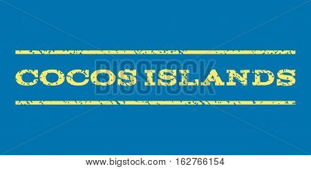 Cocos Islands watermark stamp. Text caption between horizontal parallel lines with grunge design style. Rubber seal stamp with dirty texture. Vector yellow color ink imprint on a blue background.