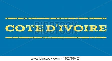 Cote D'Ivoire watermark stamp. Text tag between horizontal parallel lines with grunge design style. Rubber seal stamp with scratched texture. Vector yellow color ink imprint on a blue background.