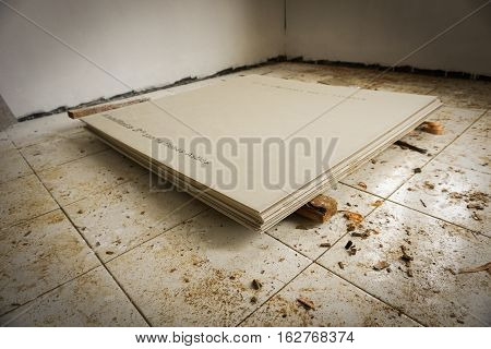 Flooring with white tiles and making roofs photo taken in Bogor Indonesia java
