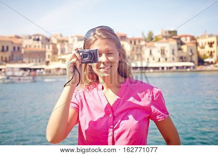Woman photographing sights in Crete during travelling