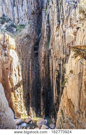 Hiker woman walking along the Caminito del Rey path Malaga Spain