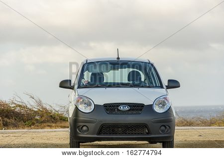 White Old Kia Picanto City Car On Desert