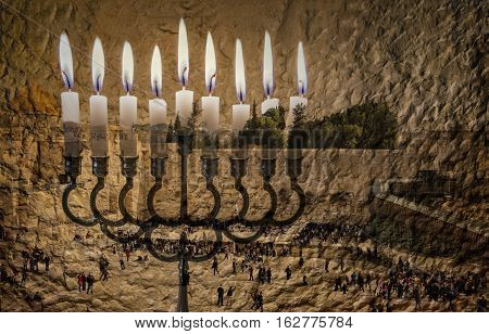 Composite image of menorah with glittering candles and western wall in Jerusalem. The image symbolizes Hanukkah Holiday and Jewish desires and hopes. Selective focus. Toned for retro style