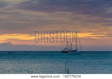 The Golden Hour With  Sail Boats On Sea Anchored