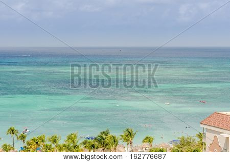 Tourists Enjoying The Beatiful Blue Caribbean Sea