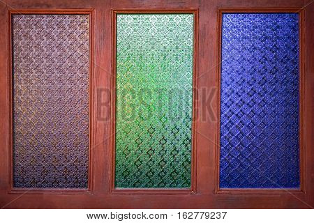 Old wooden windows with the opaque glass.