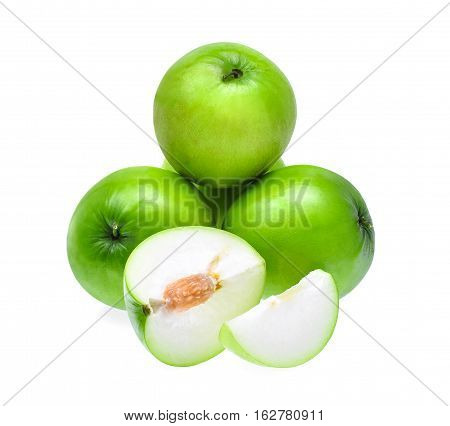 green fresh monkey apple with slices isolated on white background