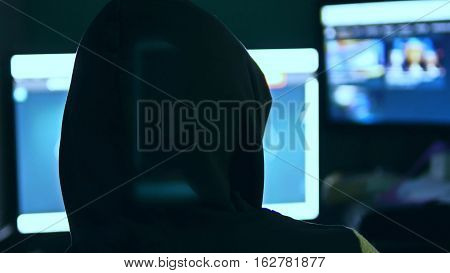 Hacker man, trying to breach security of computer system internet search
