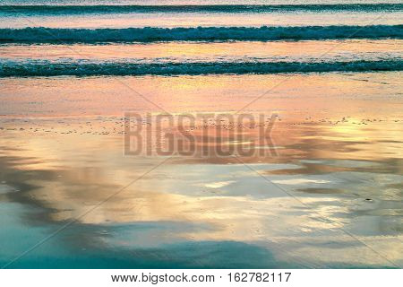 reflections on beach water during sunset from nicaragua