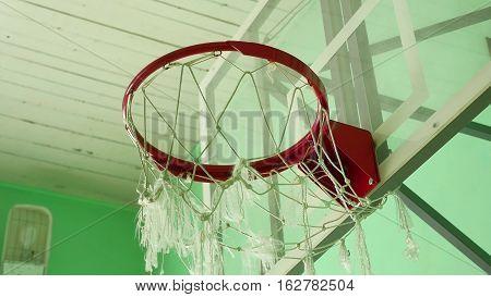 basketball hoop and billboard in the school gym sport