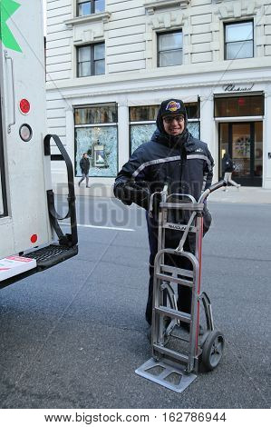 NEW YORK - DECEMBER 15, 2016: FedEx driver delivers packages during Holidays season in Manhattan.