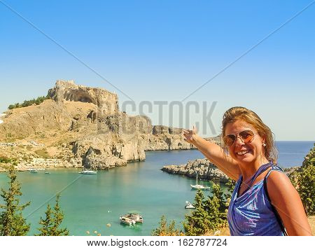 Tourist Introducing Saint Paul Bay And Beach In Lindos