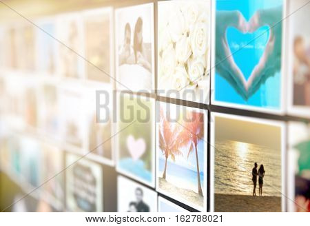 Colorful pictures of husband wife or boyfriend girlfriend magnets on the black board or wall. Photo of happy couple enjoy vacation times with good memories Valentines day Concept. Focus on palm tree.