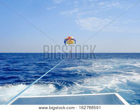 Parasailing In A Blue Sky In Santorini Beach
