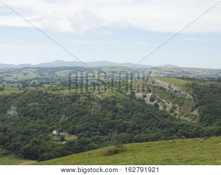 Summer rolling hills, valley showing Snowdonia mountains in the background UK Wales