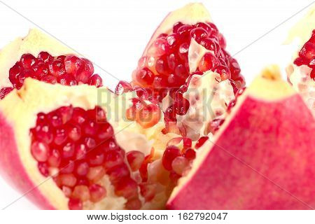 beautiful ripe tropical fruit pomegranate have broken into pieces