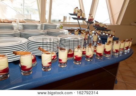 White And Red Tiramisu With Gingerbread In Boat Cruise Ship