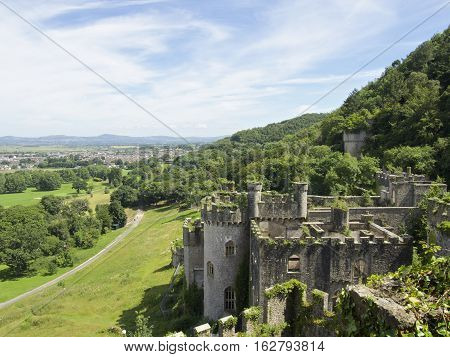 Gwrych Castle In Wales Uk To The Side Surrounded By Foliage On Hill Side Overlooking The Town Of Abe