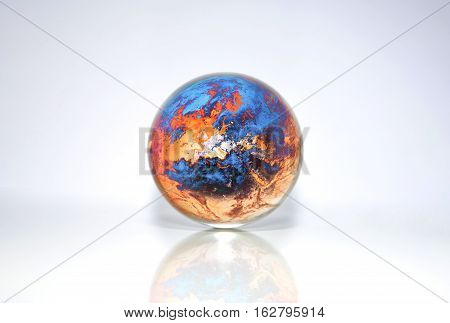 Orange & Blue Planet Earth in crystal ball, Elements of this image furnished by NASA