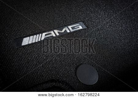 Sankt-Petersburg, Russia October 22, 2016 : Close up of logo AMG on Mercedes-Benz CLA 45 2016 car mat in interior, test drive on October 22 2016 in Russia.