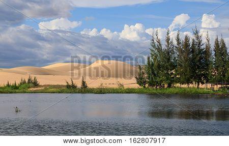 Beautiful landscape with lake and white dunes near Mui Ne place Vietnam