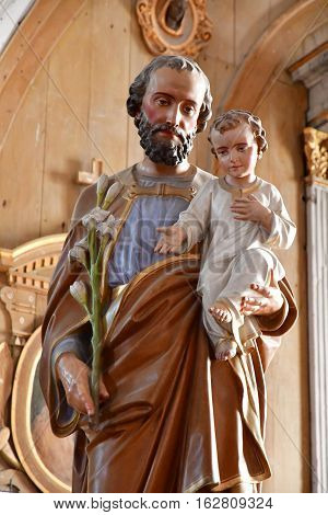 Ars en Re France - september 26 2016 : statue of Joseph and Jesus in the Saint Etienne church