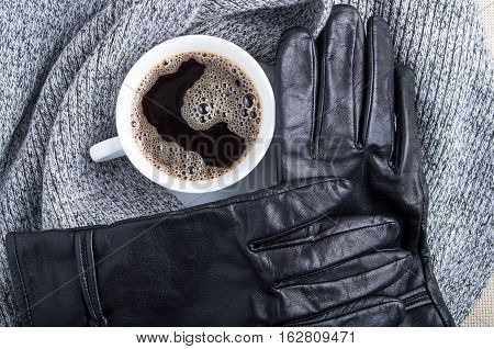 Top View Of A White Cup Of Coffee And Gray Woolen Scarf