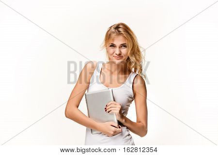 Portrait of beautiful smiling girl making selfie with modern laptop in hands on white background.