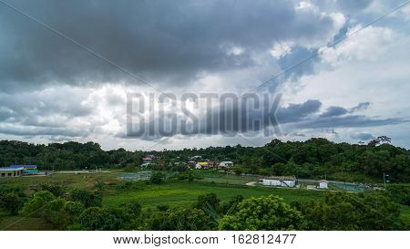 Rainy cloudy sky over Bukit Kuda village in Labuan,Malaysia.The village next to Labuan's largest natural reservoir,the Bukit Kuda dam,which supplies the island with most of its fresh drinking water.