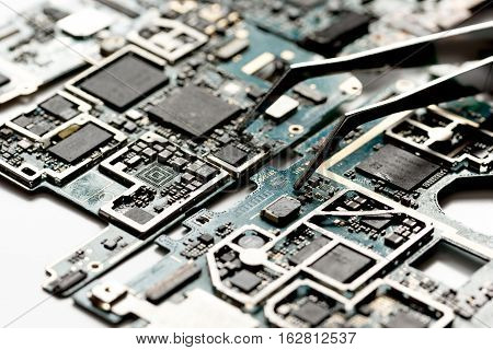concept repair smartphone gadgets on white background close up