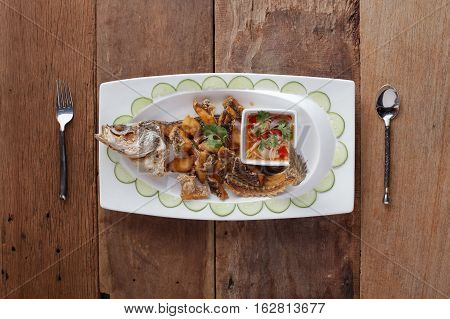 Fried Seabass with garlic On table, ready to eat