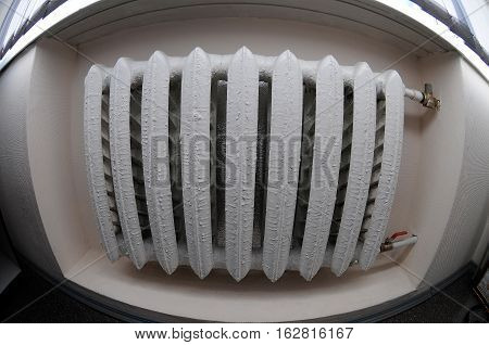 the a white heater on a white wall