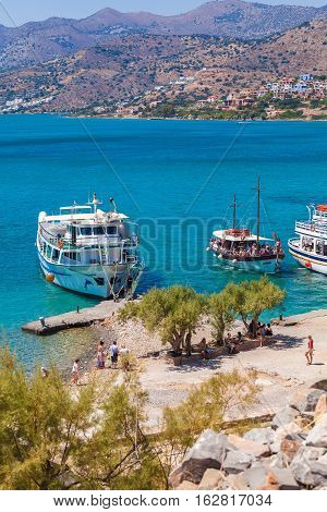 Spinalonga, Crete - July 31, 2012:  The Excursion Boat Took A Group Of Tourists To Visit  Spinalonga