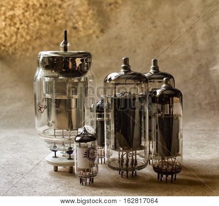 vertical composition of old radio lamps on kraft paper. vintage electronic background
