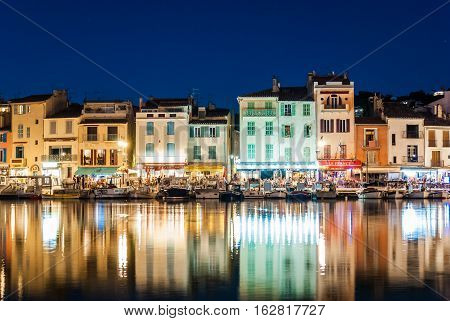 CASSIS FRANCE - AUGUST 24 2016: Summer night view of the promenade of Cassis a small touristic town in southern France near Marseille
