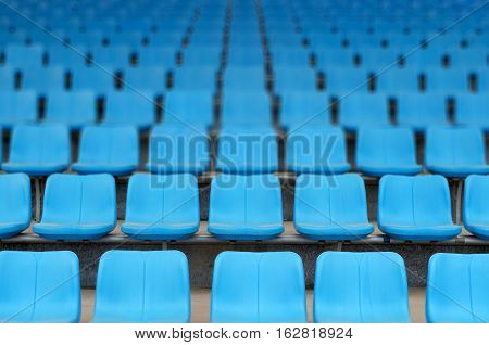Rows of stadium grandstand seats in playground