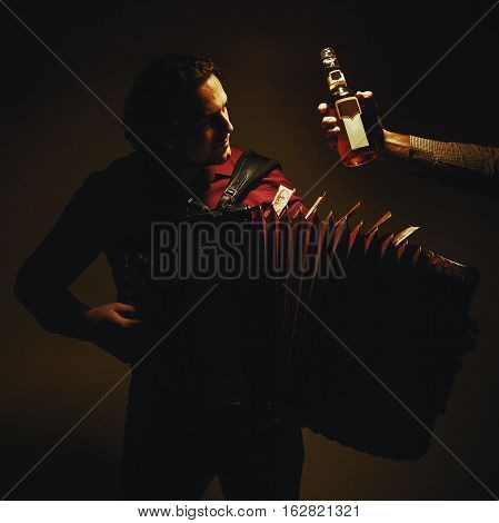 Chromatic Accordion Player And Bottle Of Spirit Drink